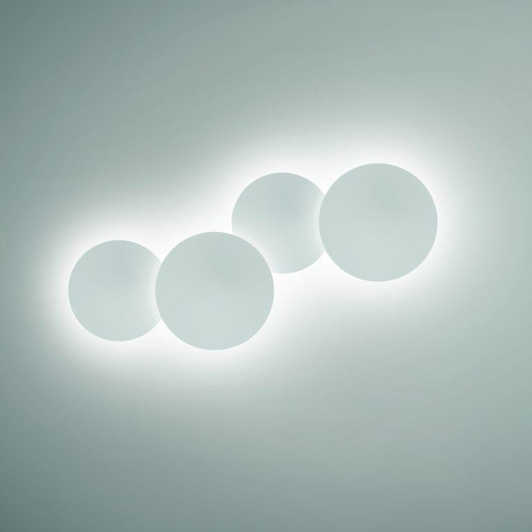 0. interiorisme_retail_clinica dental_il.luminació_puck wall art_vibia